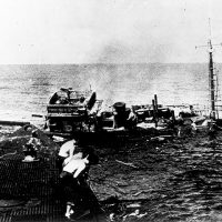 Battle surface sinking and a prisoner.