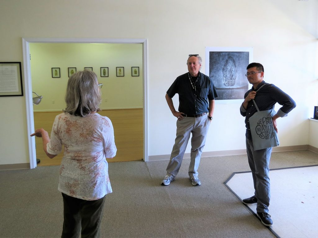 From left: Gallery owner Deborah McLeod with artists John Grant and Binh Danh